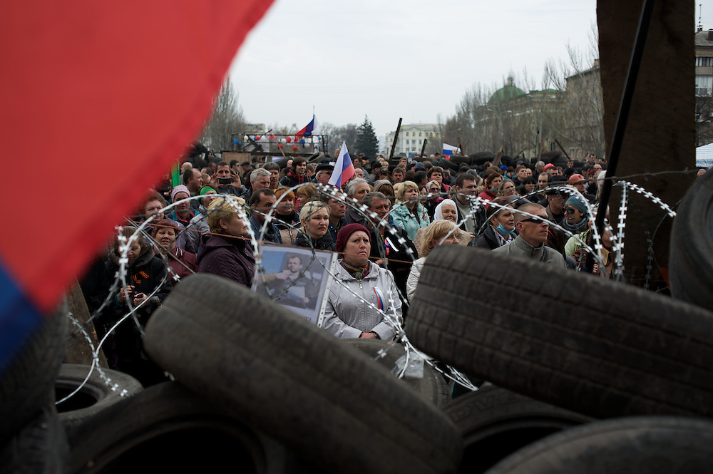 Pro-Russia protestors attend a rally outside the Donbass Regional Government building in central Donetsk. Barricades around the building, occupied since the past weekend, have been fortified throughout the day, as the ultimatum given by the government in Kiev for the activists to abandon the building within 48 hours, is approaching its deadline.
