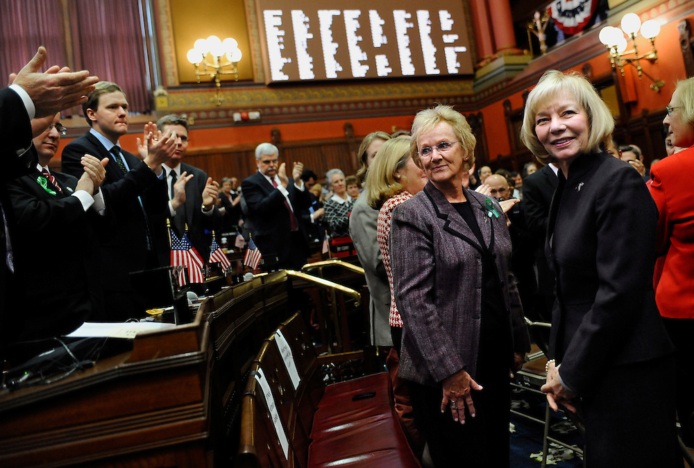 Newtown First Selectwoman Pat Llodra, center left, and Newtown School Superintendent  Dr. Janet Robinson, center right, receive a standing ovation inside the Hall of the House during Gov. Dannel P. Malloy's State of the State address the at the Capitol in Hartford, Conn., Wednesday, Jan. 9, 2013. Malloy urged state lawmakers Wednesday to work with him to prevent future tragedies like the Sandy Hook Elementary School shooting, but stressed that ?more guns are not the answer.?  Legislators also must grapple with a projected deficit of about $1.2 billion. (AP Photo/Jessica Hill)