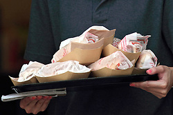 23 August 2014:  Hotdogs and hamburgers on a tray waiting to be served
