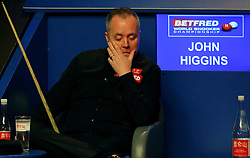 John Higgins reacting during day seventeen of the Betfred Snooker World Championships at the Crucible Theatre, Sheffield.