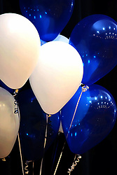 08 February 2008:  Balloons anchored by ribbons decorate a stage