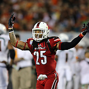 Louisville Cardinals safety Calvin Pryor (25) celebrates during the NCAA Football Russell Athletic Bowl football game between the Louisville Cardinals and the Miami Hurricanes, at the Florida Citrus Bowl on Saturday, December 28, 2013 in Orlando, Florida. Louisville won the game by a score of 36-9. (AP Photo/Alex Menendez)