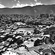 Caracas - Venezuela. View of Caracas west end area. Lack of development programs and centralization of all important social and economic activities have over populated a city that hardly can answer to the needs of its inhabitants. It is in the barrios where the majority of violent situations take place and from where come the 86% of the victims and victimizers.