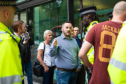 © Licensed to London News Pictures. 19/07/2019. London, UK. James Goddard (centre) speaks with police as he arrives at Westminster Magistrates Court for the start of a two-day trial for harassment of Remain-supporting MP Anna Soubry. Photo credit: Rob Pinney/LNP