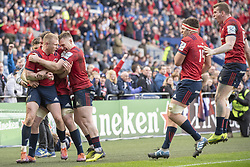 March 30, 2019 - Edinburgh, Scotland, United Kingdom - Munster players celebrate Keith Earls scoring during the Heineken Champions Cup Quarter Final match between Edinburgh Rugby and Munster Rugby at Murrayfield Stadium in Edinburgh, Scotland, United Kingdom on March 30, 2019  (Credit Image: © Andrew Surma/NurPhoto via ZUMA Press)