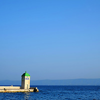 Bol Harbour Tower and wall with open sea;<br />Bol, Brac, Croatia.