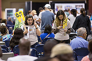 Volunteers call out patients names during a free medical mission held by the SC Dental Association on August 23, 2013 in North Charleston, South Carolina. More than 1,000 people showed up to receive free dental and medical care.