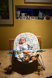 8 week old baby in bouncy chair UK