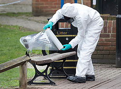 © Licensed to London News Pictures. 23/03/2018. Salisbury, UK. Police in protective suits and gas masks use plastic to wrap the bench where former Russian spy Sergei Skripal and his daughter Yulia were poisoned with nerve agent in Salisbury. The couple where found unconscious the bench in Salisbury shopping centre on 4th March 2018. Photo credit: Peter Macdiarmid/LNP
