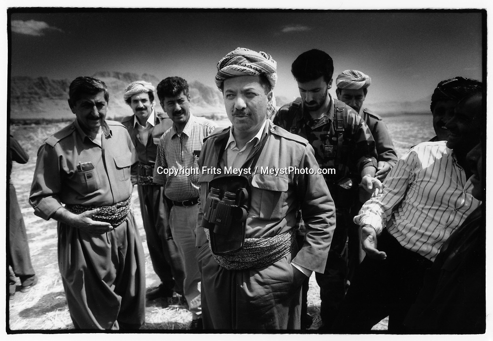 RANIYAH, KURDISTAN, IRAQ, 09.09.96. KDP  KDP Leader Massoud Barzani Stops in a field on the way to Suleymaniyah, to discuss the strategics with his commanders . ©Photo by Frits Meyst/NewsImages