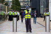Security and Police keep a close eye on Extinction Rebellion 'Shell Out' protest on 8th September 2020 in London, United Kingdom. The environmental group gathered outside the Shell building to protest at the ongoing extraction of fossil fuels and the resulting environmental record. Extinction Rebellion is a climate change group started in 2018 and has gained a huge following of people committed to peaceful protests. These protests are highlighting that the government is not doing enough to avoid catastrophic climate change and to demand the government take radical action to save the planet. (photo by Andrew Aitchison / In Pictures via Getty Images)