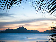Group of people wading in quiet waters, Palawan Island, Philippines, Southeast Asia