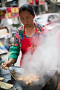 Chinese street food vendor cooks tofu cheese in Datong, July 23, 2014.<br /> <br /> Food and games are a real pleasure for the life of Chinese community. <br /> At home, in the streets, at the park or in restaurants, the chance to find someone eating or playing is considerably high.<br /> <br /> © Giorgio Perottino