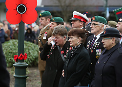 A woman wipes her eye during a remembrance service in Fort William on the 100th anniversary of the signing of the Armistice which marked the end of the First World War.