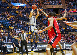 Dec 1, 2018; Morgantown, WV, USA; West Virginia Mountaineers guard Jordan McCabe (5) shoots a jumper during the second half against the Youngstown State Penguins at WVU Coliseum. Mandatory Credit: Ben Queen-USA TODAY Sports