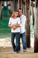 1 August 2008:  Jeff Alba (38), Sue Alba (37),  Husband and Wife pose for a photo under the pier at the beach.