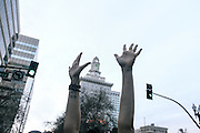 A person holding there hands up in downtown Oakland, CA 2014