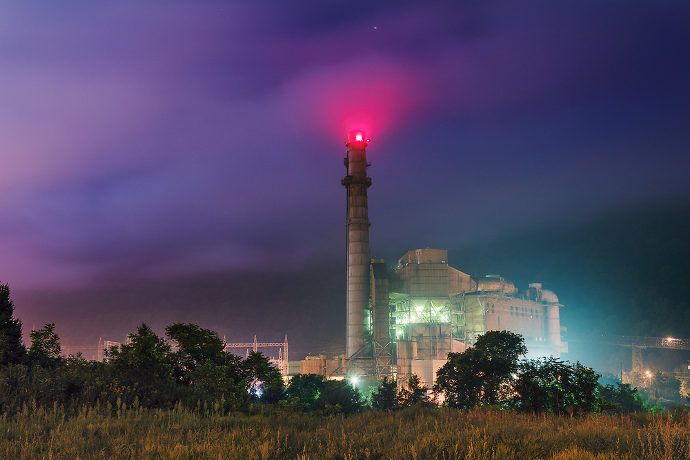 The Kanawha River power plant, shut down since 2015, is seen on a moonlit night in Glasgow, W,Va., on Monday night, August 28, 2018.