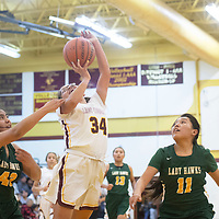 Tohatchi Cougar Sierra Peterson (34) is fouled by Thoreau Hawk Brook Capitan (43) as she drives to the basket Tuesday night at Tohatchi High School in Tohatchi. Tohatchi beat Thoreau 51-46.