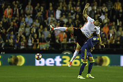 April 6, 2017 - Valencia, Comunidad Valenciana, Spain - Valencia CF vs Real Celta de Vigo - La Liga Matchday 30 - Estadio Mestalla, in action during the game -- Siqueira, left defender for Valencia CF, jumps over Roncaglia (right) from Celta de Vigo (Credit Image: © Vwpics/VW Pics via ZUMA Wire/ZUMAPRESS.com)