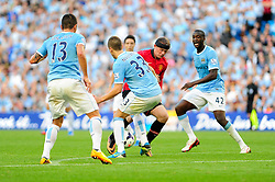 Manchester United's Wayne Rooney runs into Manchester City's Matija Nastasic - Photo mandatory by-line: Dougie Allward/JMP - Tel: Mobile: 07966 386802 22/09/2013 - SPORT - FOOTBALL - City of Manchester Stadium - Manchester - Manchester City V Manchester United - Barclays Premier League