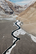 The Wakhan river, tributary of the Amu Darya river..Flight with Kodiak plane from Kabul to Kret village (Wakhan Corridor), over the Panshir valley.