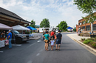 Johnson City, Tennessee, USA - August 7, 2021: At the Saturday farmers' market in Johnson City, people wait in a long line to make a purchase at Auntie Ruth's Doughnuts, a small but popular family-owned bakery on wheels.