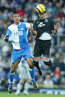 Fotball<br /> Premier League England 2004/2005<br /> 18.12.2004<br /> Foto: SBI/Digitalsport<br /> NORWAY ONLY<br /> <br /> Blackburn v Everton<br /> Barclays Premiership. 18/12/2004. <br /> <br /> Alessandro Pistone of Everton jumps for a header with Jay Bothroyd of Blackburn Rovers.