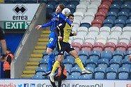 Joe Bunney wins a challenge during the EFL Sky Bet League 1 match between Rochdale and Scunthorpe United at Spotland, Rochdale, England on 23 March 2019.