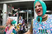 Extinction Rebellion 'Dirty Scrubbers' old fashioned washer women in curlers wash and launder their 'dirty money' and greenwash stains in the City of London financial district in a performance designed to highlight the corruption of big business and banking on 9th September 2020 in London, United Kingdom. Here the protest is outside <br /> BlackRock: Investment Management & Financial Services. The activists shouted out for people to come from the banks and to bring their dirty money to be cleaned in their washing machines. Extinction Rebellion is a climate change group started in 2018 and has gained a huge following of people committed to peaceful protests. These protests are highlighting that the government is not doing enough to avoid catastrophic climate change and to demand the government take radical action to save the planet.