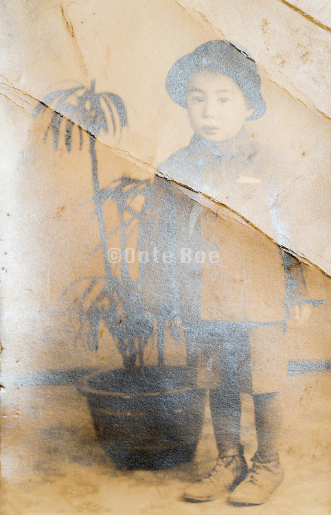 fading and cracked image of a little boy Japan ca 1940s