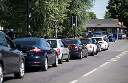 © Licensed to London News Pictures. 20/05/2020. Staines, UK. Long queues at a McDonalds Drive Thru in Staines, Surrey. Branches of McDonalds restaurants have opened for drive thru today for the fist time since lockdown.  todayGovernment has announced a series of measures to slowly ease lockdown, which was introduced to fight the spread of the COVID-19 strain of coronavirus. Photo credit: Ben Cawthra/LNP
