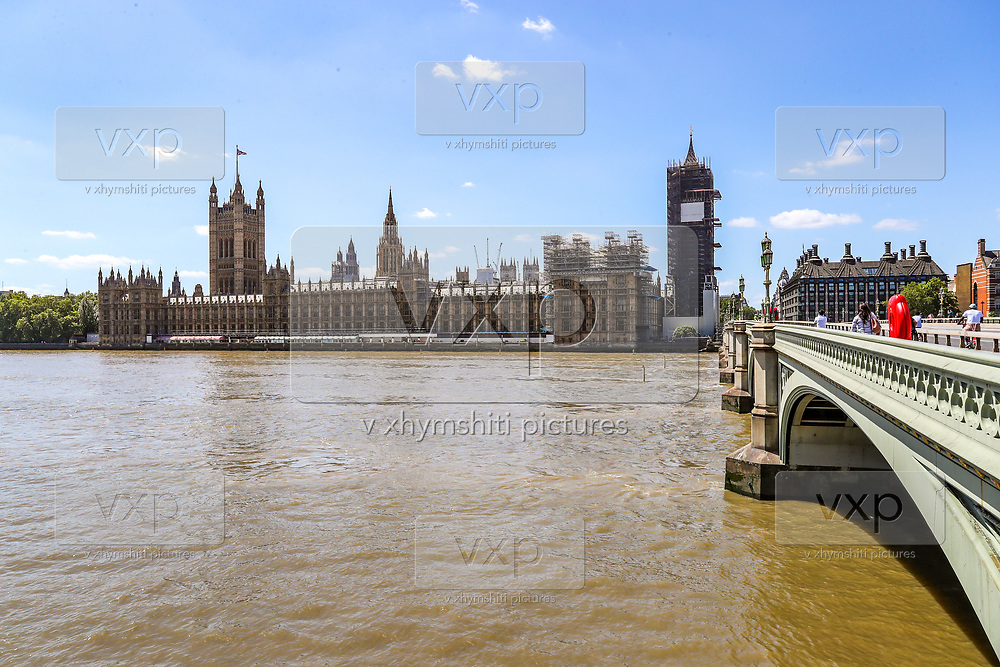 The under-renovation Elizabeth Tower of the Houses of Parliament overlooks a near-deserted Westminster Bridge in London, England, on Monday, June 22, 2020. (Photo/Vudi Xhymshiti)