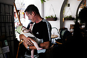 KRAKAU, POLAND - 15/07/2005 - Father carrying his daughter on the streets of Krakau<br /> <br /> © Christophe VANDER EECKEN