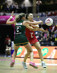 England Vitality Roses' Jade Clarke (right) and South Africa Spar Proteas Erin Burger battle for the ball during the Vitality Netball International Series match at The Copper Box, London.