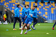 AFC Wimbledon defender Nesta Guinness-Walker (18) warming up prior to kick off during the EFL Sky Bet League 1 match between AFC Wimbledon and Sunderland at Plough Lane, London, United Kingdom on 16 January 2021.