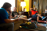 Johny Hendricks checks into his hotel prior to UFC 171 and goes over his diet schedule with coach Mike Dolce and manager Tim McBride at his hotel room in Dallas, Texas on March 11, 2014.