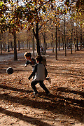 Two young boys playing football in  Jardin du Luxembourg, town of Paris, France