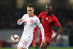 November 20, 2018 - Guimaraes, Guimaraes, Portugal - Piotr Zielinski midfielder of Poland (L) in action with Danilo Pereira defender of Portugal during the UEFA Nations League football match between Portugal and Poland at the Dao Afonso Henriques stadium in Guimaraes on November 20, 2018. (Credit Image: © Dpi/NurPhoto via ZUMA Press)