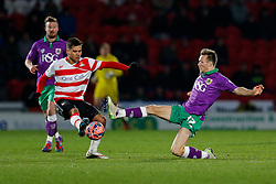 Todd Kane of Bristol City makes a challenge on Harry Forrester of Doncaster Rovers - Photo mandatory by-line: Rogan Thomson/JMP - 07966 386802 - 03/01/2015 - SPORT - FOOTBALL - Doncaster, England - Keepmoat Stadium - Doncaster Rovers v Bristol City - FA Cup Third Round Proper.