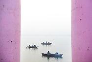 Boats in the mist at dawn on the Ganges River, Varanasi, Uttar Pradesh, India
