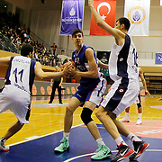 Anadolu Efes's Emircan Kosut (C) during their Turkish Basketball League match Istanbul BSB between Anadolu Efes at Cebeci Arena in Istanbul Turkey on Monday 09 March 2015. Photo by Aykut AKICI/TURKPIX
