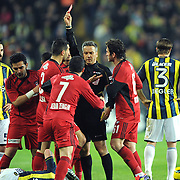 Referee's Mustafa Kamil Abitoglu show the red card to Gaziantepspor's Kerim Zengin during their Turkish superleague soccer match Fenerbahce between Gaziantepspor at the Sukru Saracaoglu stadium in Istanbul Turkey on Monday09 January 2011. Photo by TURKPIX