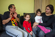"""Volunteer Jolana Smarhovycova (right) with Kristina and her father Eduard Polanski (47) with his daughter Sara (6) in their temporary home in Ostrava. Sara's mother was advised from one of the schools that she should not enrol her daughter there - after the girl passed the enrolment test - because Sara is so """"slim"""". Mother Ingrid Kandracova (36) new that the final decision is on her side and she refused the advice and enrolled her daughter in the school."""