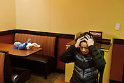 """Patrick Mason, 14, of Lebanon reacts as his interactive baby doll begins to cry as he settles in to eat dinner at Moe's in West Lebanon, Jan. 15, 2015. The dolls are given to Lebanon Middle School health class students over night for lessons on parenting.""""This is so awful. I could not imagine six months of this,"""" said Mason."""