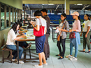 07 AUGUST 2016 - BANGKOK, THAILAND:  The line to vote at a polling place at Wat That Thong in Bangkok. Thais voted Sunday in the referendum to approve a new charter (constitution) for Thailand. The new charter was written by a government appointed panel after the military coup that deposed the elected civilian government in May, 2014. The charter referendum is the first country wide election since the coup.      PHOTO BY JACK KURTZ