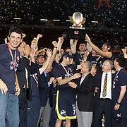 Fenerbahce players celebrate with the Turkish Beko Basketboll League championship trophy at the Abdi Ipekci Arena in Istanbul Turkey on Friday 17 June 2011. Fenerbahce Ulker wrapped up its fifth Turkish League championship and fourth in the last five years by holding on to edge Galatasaray CC 88-91 in Game 6 of the Turkish League finals on Friday in Istanbul. Photo by TURKPIX