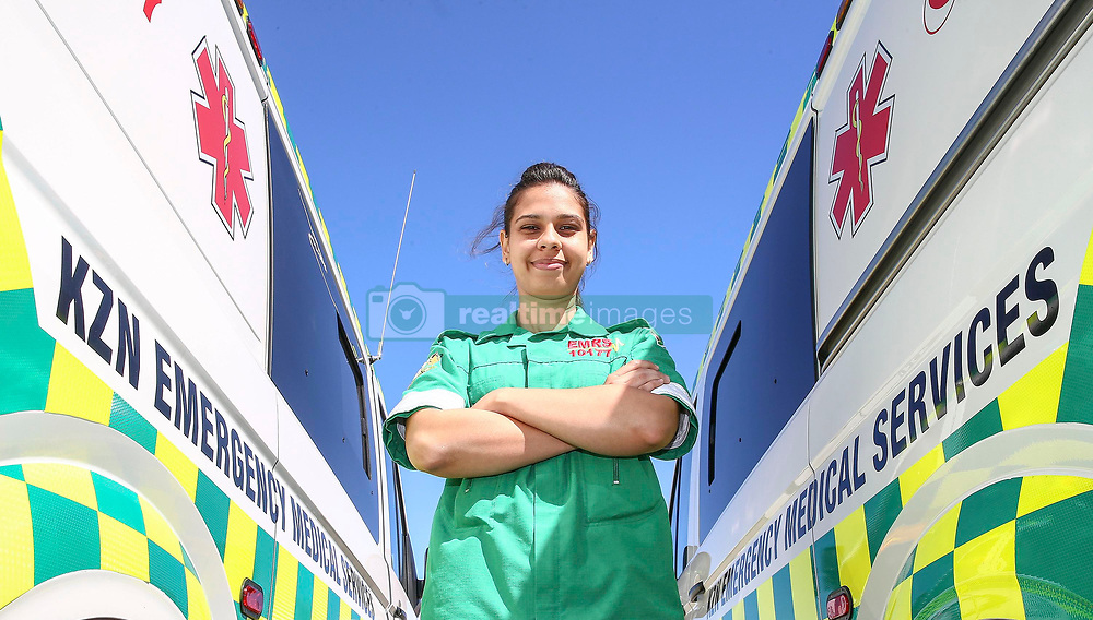 Durban. 280818. In a bid to speed up emergency response time in the province, the MEC for Health in KwaZulu-Natal handedover 100 brand new ambulances to the different districts within KZN. MEC, Dr Sibongiseni Dhlomo, said for the province's Emergency Medical Services (EMS), health service delivery in conjunction with primary healthcare and hospital services, form part of the unit's three core pillars. Ambulances are therefore basically a crucial mobile emergency clinic whose personnel are trained to resuscitate and/or stabilise a patient using sophisticated techniques, equipment and medical drugs. Therefore the significance of this handover and how it will enhance the department's ability to respond timeously to emergencies within the province cannot be overemphasised. Practitioners Shaylee Bauer  Emergency Care Practitioner with a few ambulances . Picture Leon Lestrade. African News Agency. ( ANA ).