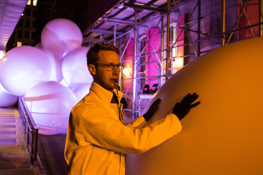 A handler starts to move an inflated ball on Jersey Street near the corner of Mulberry Street, part of the Ideas City performance by Snarkitecture.