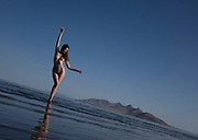 Photo of a nude woman standing in the Great Salt Lake, Utah waving a long scarf